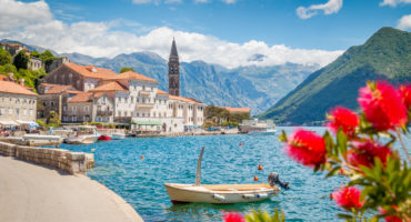 Scenic-panorama-view-of-the-historic-town-of-Perast-at-famous-Bay-of-Kotorshutterstock_1122781367